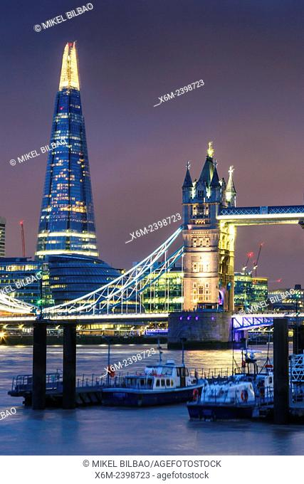 Tower Bridge, River Thames and The Shard skyscraper at night. London, United Kingdom, Europe