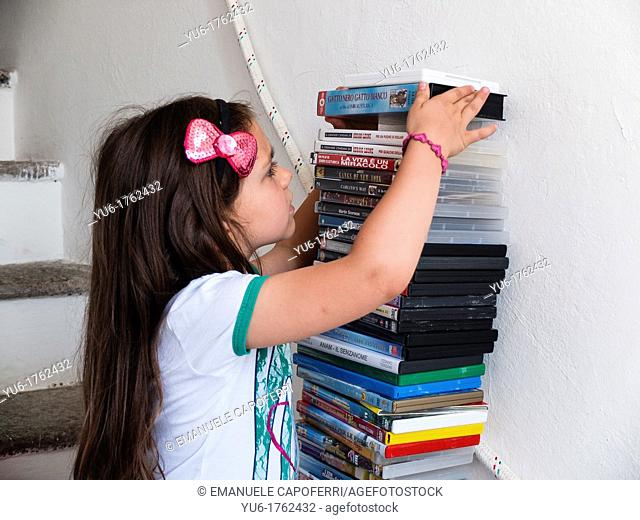 Child does tower with dvd
