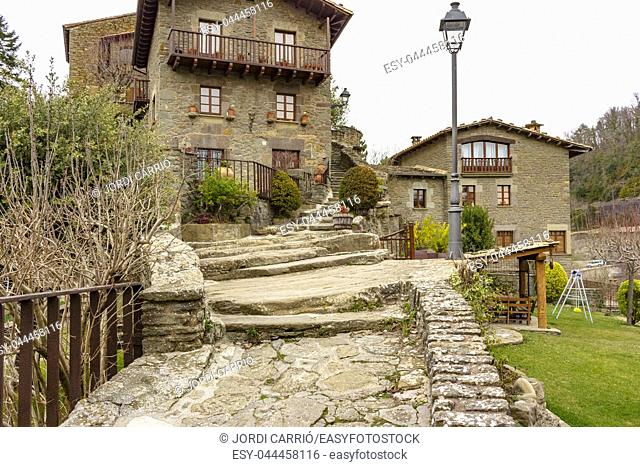Stairs of Fosar street to climb to the top of the rock where the old 11th century castle of Rupit stood. Catalonia, Spain