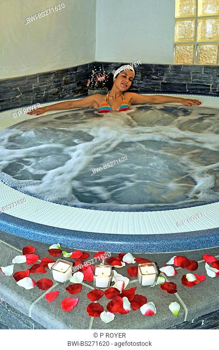 young woman relaxing in a whirl pool