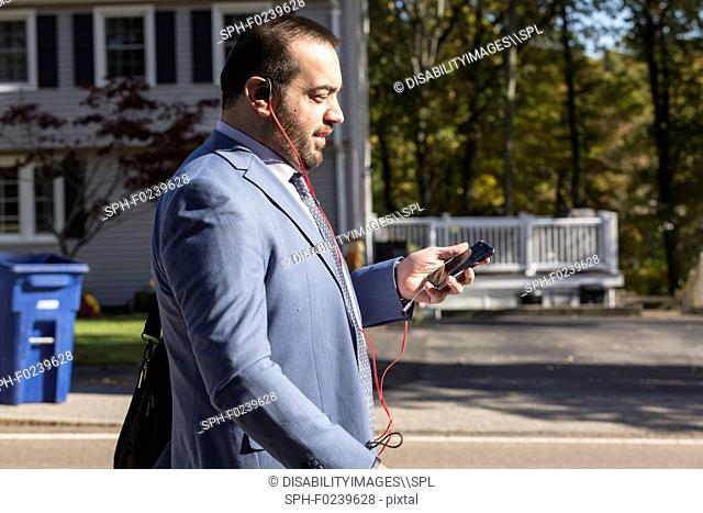 Businessman with visual impairment listening to his phone
