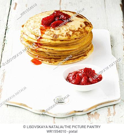 Small pancakes topped with strawberries