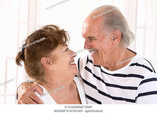 Senior couple looking at each other lovingly