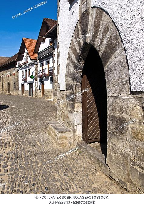 Doorway with large stone voussoirs, typical houses in front of Anduña river, Ochagavia. Navarra, Spain