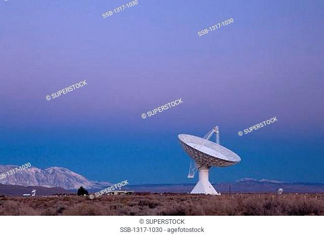 Radio telescope in a field at dawn, Owens Valley Radio Observatory, Owens Valley, California, USA