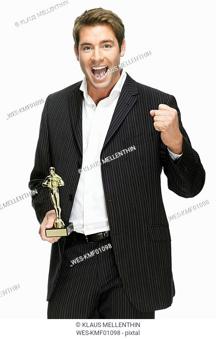 Young man with film award, cheering, portrait