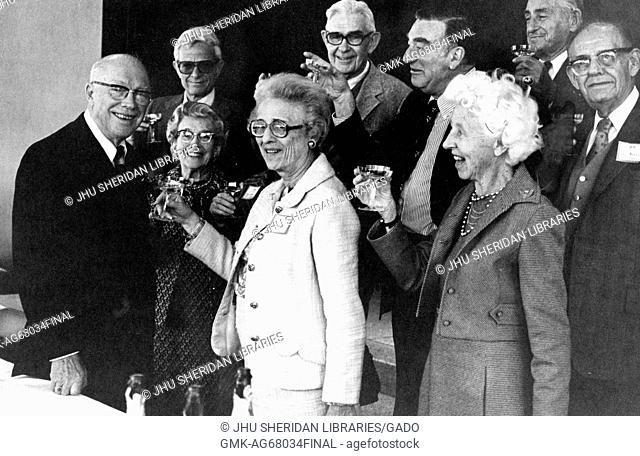 Milton Stover Eisenhower, president of Johns Hopkins University, receiving his birthday salute from alumni, 1979