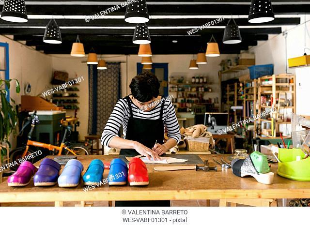 Clogmaker working in her workshop