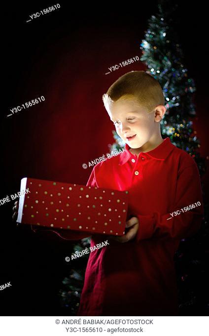 Child opening Christmas present