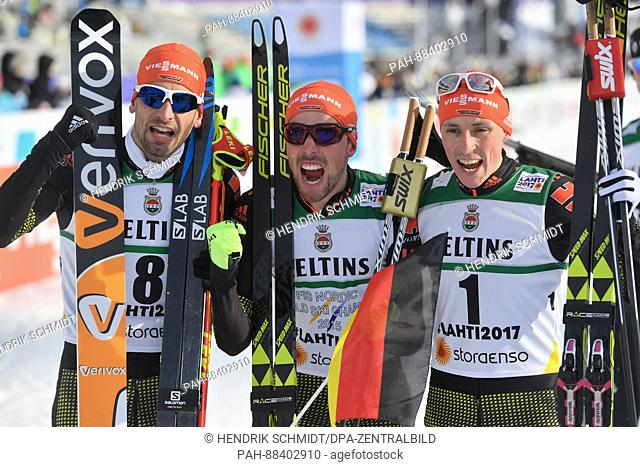 Johannes Rydzek (c, 1st Place), Eric Frenzel (r, 2nd Place) and Bjoern Kircheisen (3rd Place), all from Germany, celebrate after the single combination event...