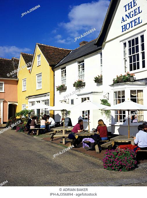 Visitors enjoying a drink outside the Angel Hotel in the old Suffolk village of Lavenham