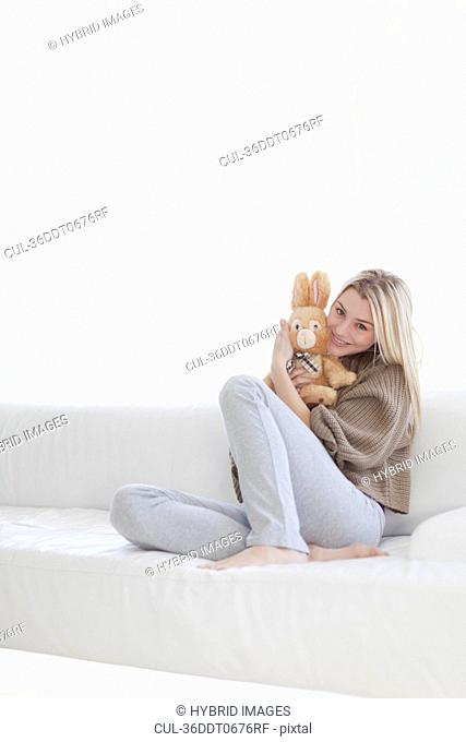 Teenage girl hugging stuffed toy