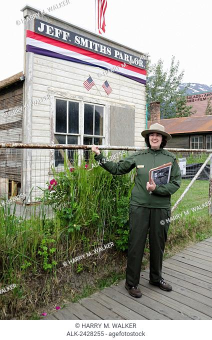 Interpretive Ranger describes history of Jeff Smith's Parlor on 2nd Ave in historic district of Klondike Gold Rush National Historical Park in Skagway Alaska