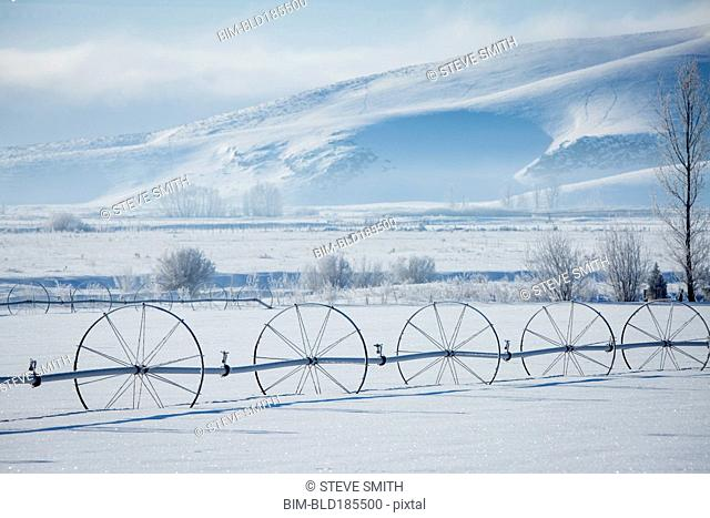 Irrigation system in snowy rural field