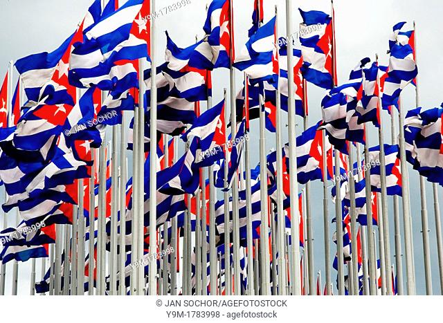 Cuban national flags wave in front of the U S  Interest Section in Havana, Cuba, 13 August 2008  In 2006 the US installed the giant electronic banner on the...