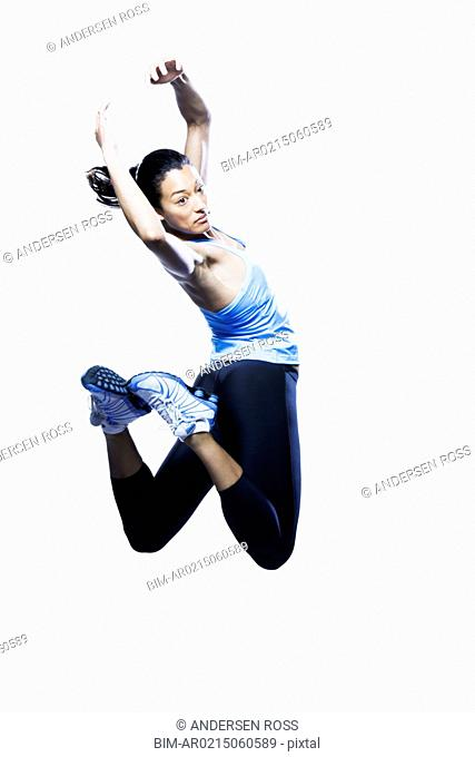 Woman jumping, Edmonds, Washington, United States