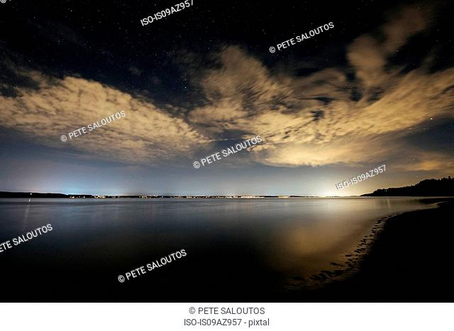 Sky and clouds over Puget Sound at night, Seattle, Washington, USA