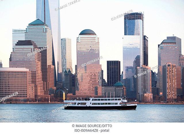 Cruise boat by New York City skyline