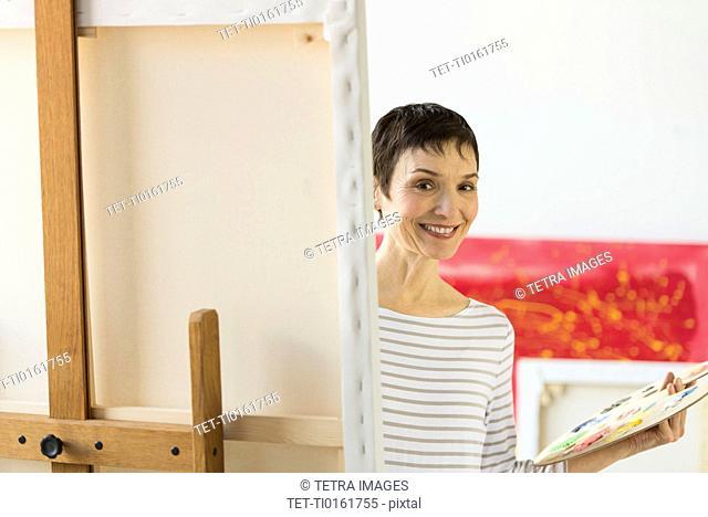 Portrait of female artist in her studio