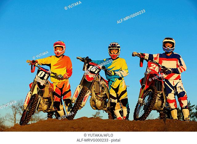 Motocross bikers on dirt track