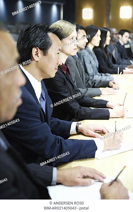 Row of businesspeople in board room