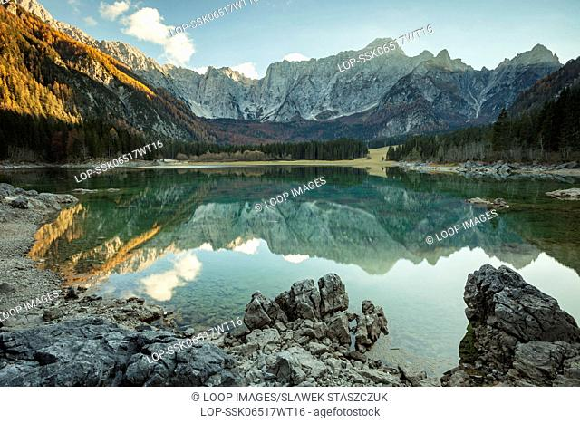 Autumn sunset at Upper Fusine lake in the Dolomites