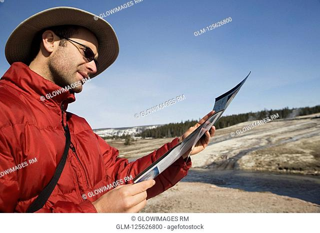 Tourist looking at a map, Yellowstone National Park, USA
