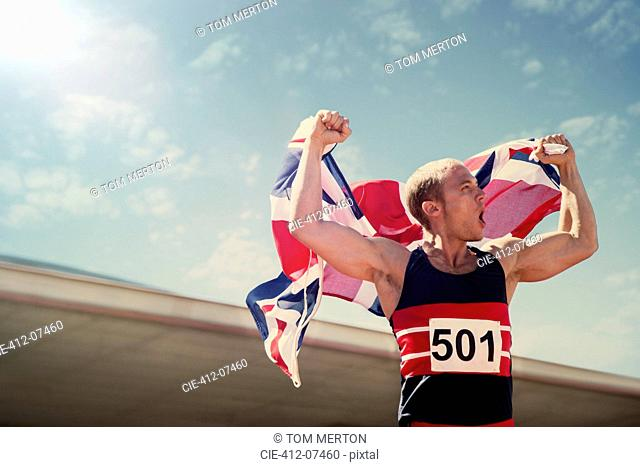 Track and field athlete holding British flag
