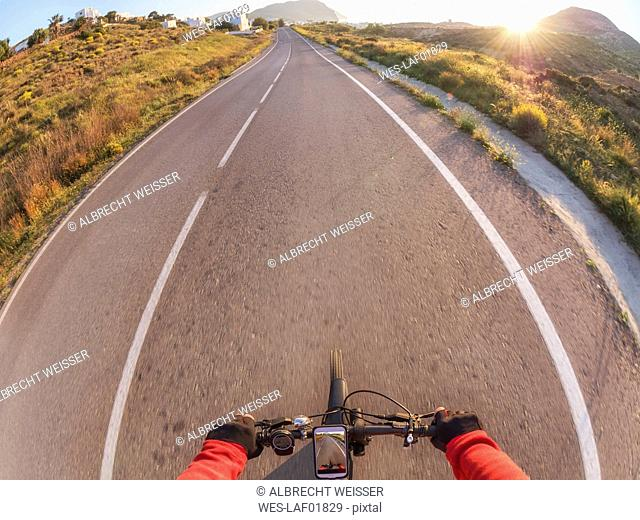 Spain, Andalusia, Cabo de Gata, personal perspective of cyclist on a street