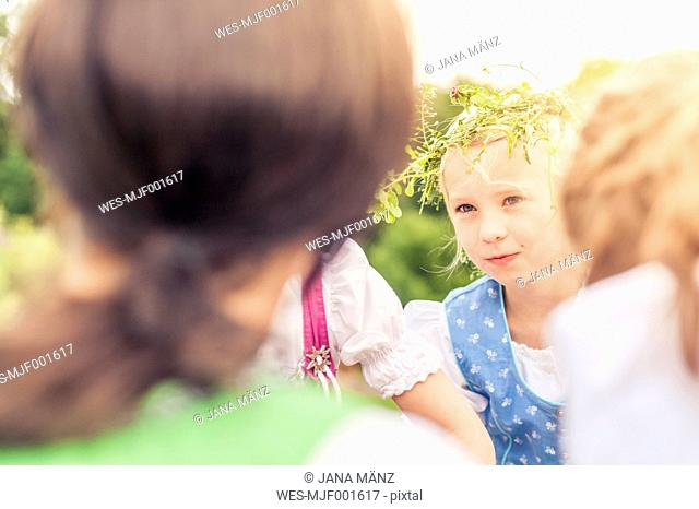 Germany, Saxony, portrait of little girl wearing floral wreath