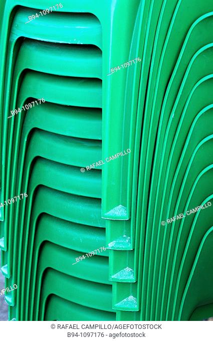Detail of green plastic chairs