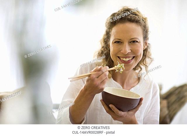 middle-aged woman eating healthy food