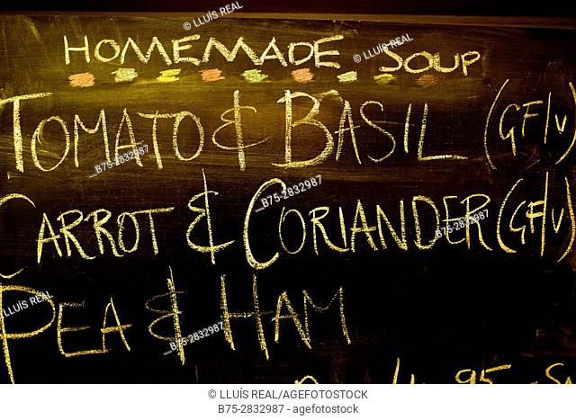 "Blackboard reading ""Homemade soup"", ""Tomato & Basil"", ""Carrot & Coriander"", ""Pea & Ham"", in a coffee shop. Starbotton, Skipton, North Yorkshire, England, UK"