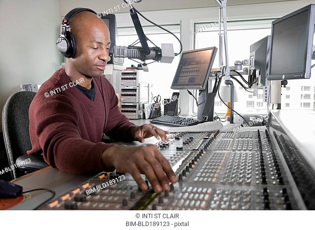 African dj working at radio station