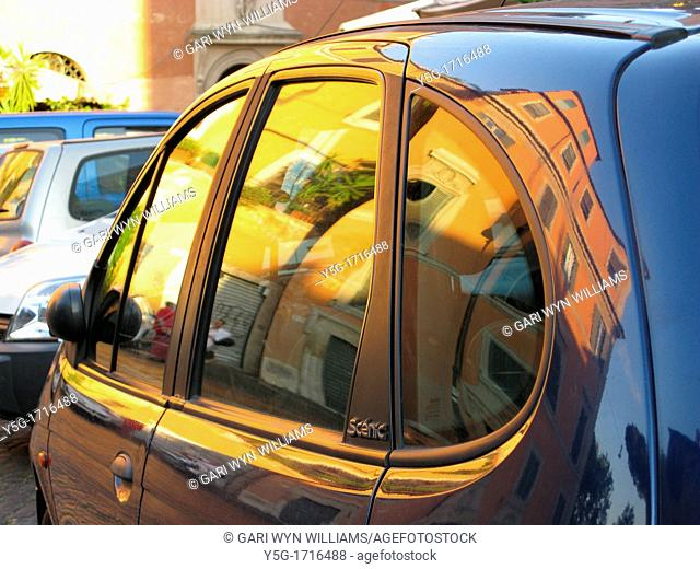 buildings reflected in renault scenic car window in trastevere, rome