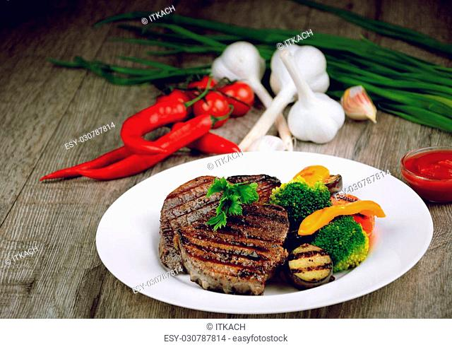 Delicious hot grilled beef steakes on the table