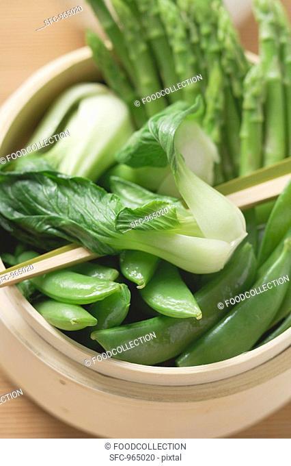 Pak choi, sugar snap peas & asparagus in bamboo steamer Asia