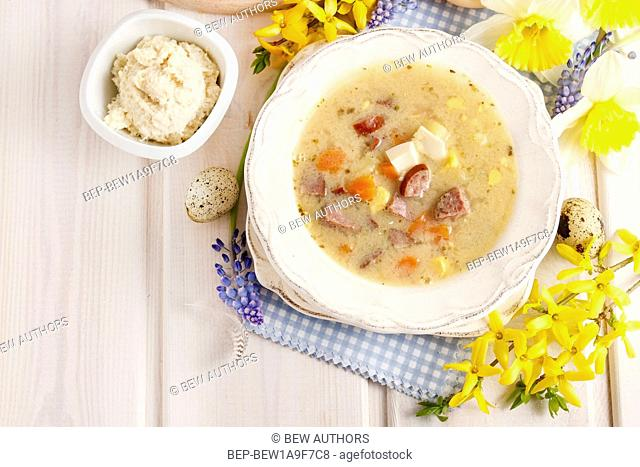 The sour rye soup made of soured rye flour and meat (usually boiled pork sausage or pieces of smoked sausage, bacon or ham)
