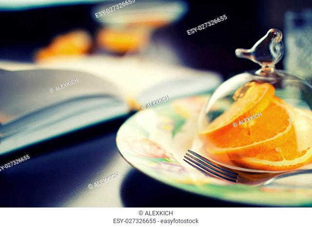 ripe fresh juicy oranges sliced on a glass plate