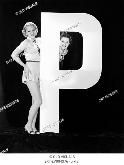 Women with huge letter P All persons depicted are not longer living and no estate exists Supplier warranties that there will be no model release issues