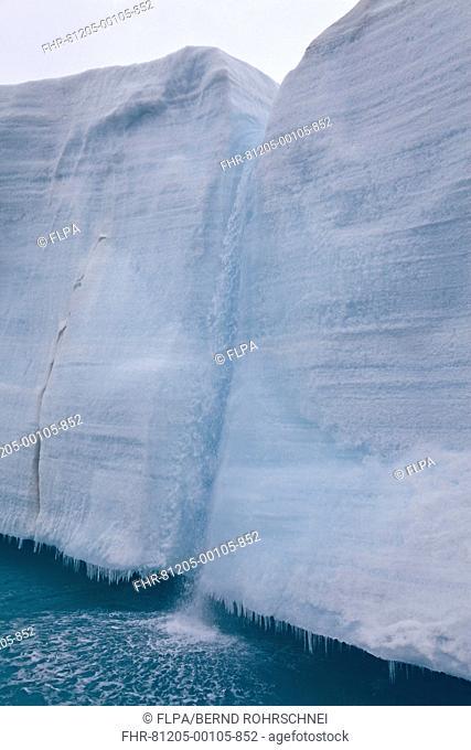 Coastal glacier terminus with waterfall from melting ice, Brasvellbreen Glacier, Nordaustlandet, Svalbard, august