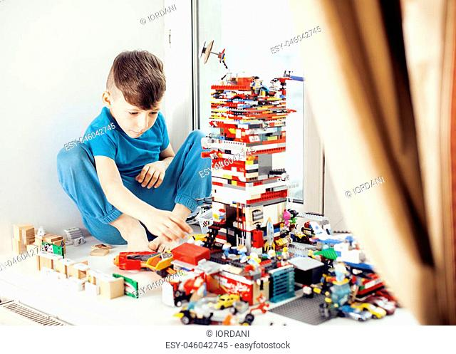 little cute preschooler boy playing toys at home happy smiling, lifestyle children concept