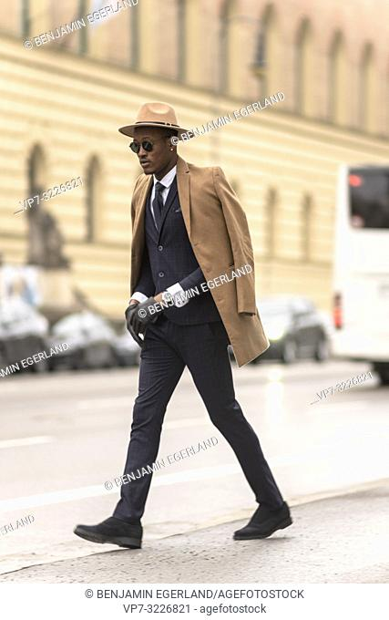 Fashionable man walking in the city. Munich, Germany