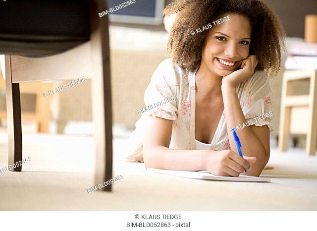 African woman writing on note pad