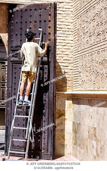 Spain, Europe, Spanish, Hispanic, Toledo, Hispanic, man, ladder, repair, renovation, working, door