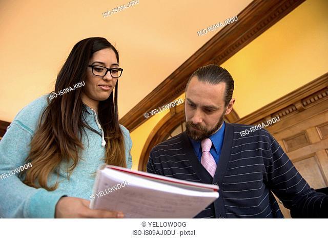 Student showing teacher notbook