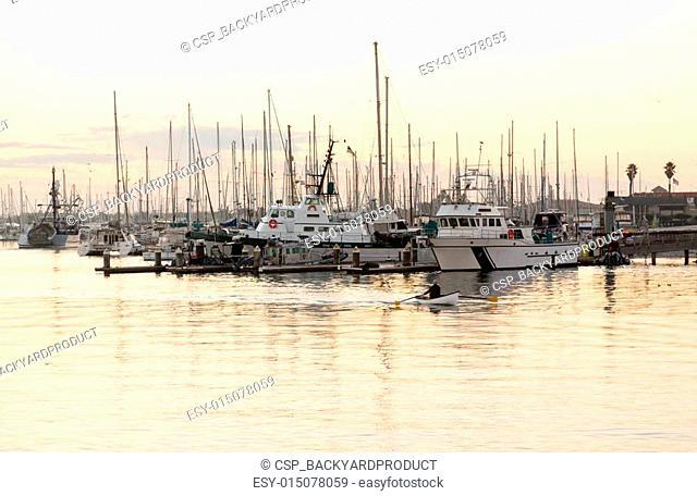 Rowing boat entering Ventura harbor dawn
