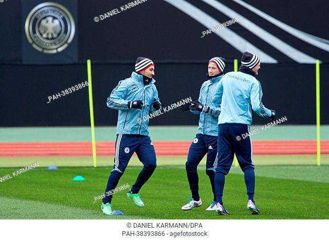 Ilkay Guendogan (l-r), Marco Reus and Andre Schuerrle of Germany attend a training session prior to the FIFA World Cup 2014 qualification group C soccer match...