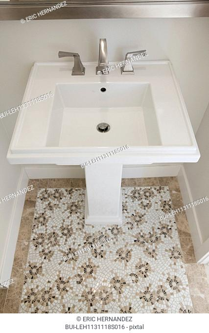 Pedestal washbasin with mosaic floor in the bathroom at home; Irvine; California; USA