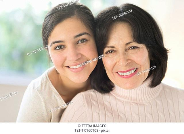 Portrait of grandmother and granddaughter 16-17